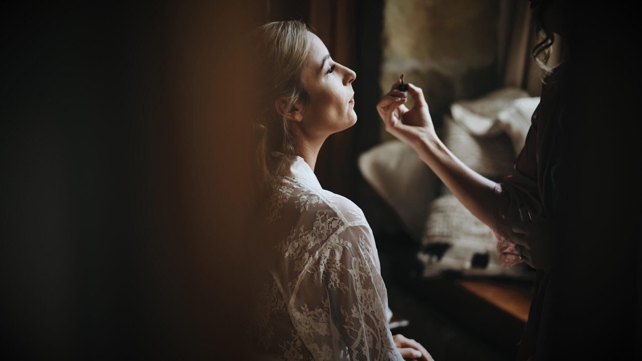 Image of bride in a dark room taken from her wedding film